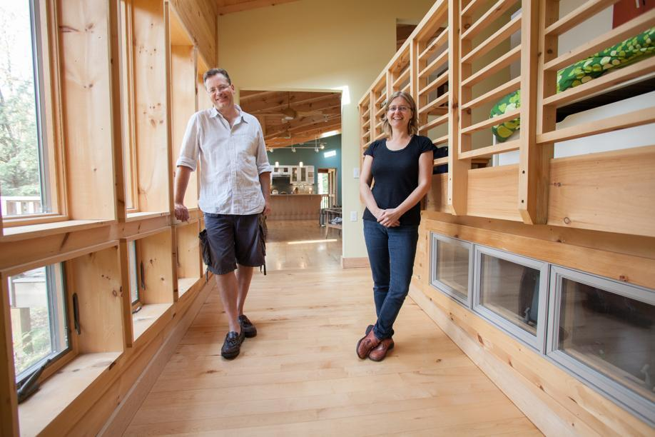 Joseph Lynch and Kristin Miller in a wheelchair-accessible hallway in their recently renovated vacation home in the Berkshires.